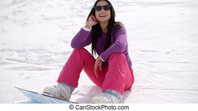 Gorgeous young woman using a snowboard - Gorgeous young...