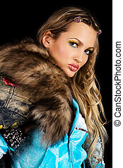 Gorgeous young woman with fur clothing
