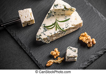 Gorgonzola cheese on black background