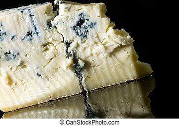 Gorgonzola - Piece gorgonzola cheese isolated on black with ...