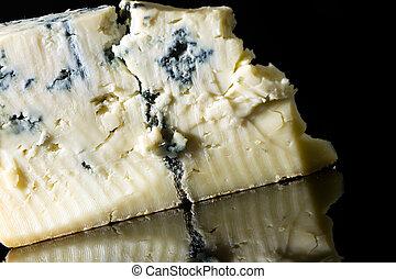 Gorgonzola - Piece gorgonzola cheese isolated on black with ...