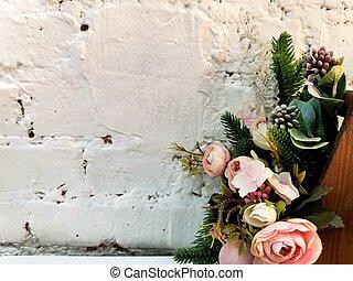 flower bouquet near white brick wall. gorizontal photo. white brick background