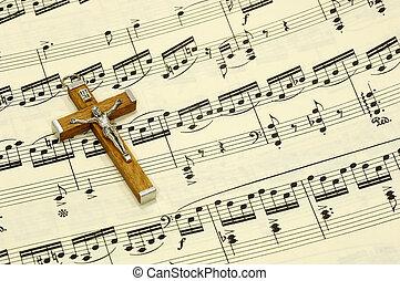 Gospel - Crucifix on top of Sheet Music