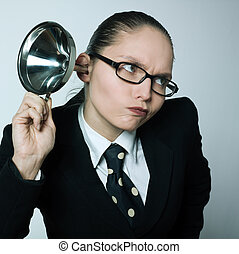 studio shot portrait of one caucasian curious business woman hearing aid funnel curious spying gossip