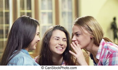 Gossip Girls - Close up of three girls having frothy talk