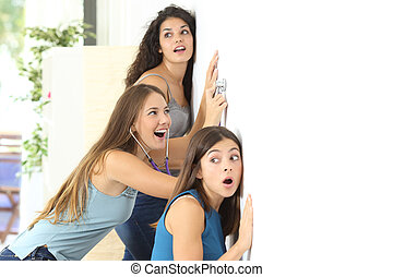 Gossip girls listening to the neighbour - Three gossip girls...