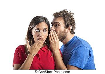Gossip - Concept of gossip with boy whispers girl
