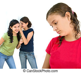 Gossip - two young girls laughing behind another girls back
