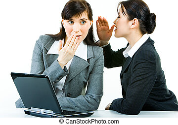 Gossiping - Portrait of business woman telling a secret to...
