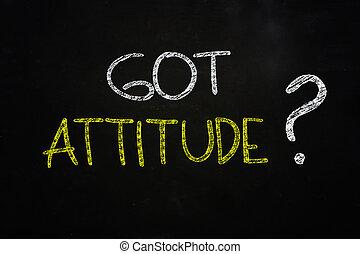 got attitude ? quote written with chalk on blackboard