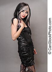 Pretty girl with goth hair in a vintage black dress