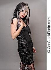 Goth girl - Pretty girl with goth hair in a vintage black...