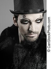 Goth male - close-up portrait of young male goth model in...