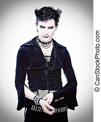 goth-style man in black dress photo