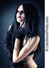 Goth woman fashion. On dark background.