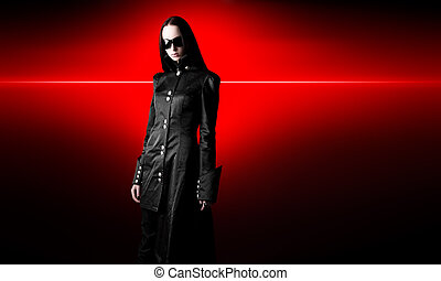 Goth woman in black cloak. On red shine background.
