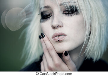 Goth woman with white hair outdoors portrait. Shallow dof effect.