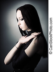 Goth woman portrait. Soft colors.