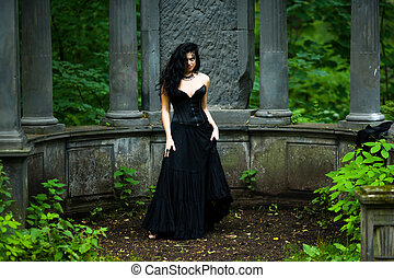Goth - Young beautiful demonic female creature walking...