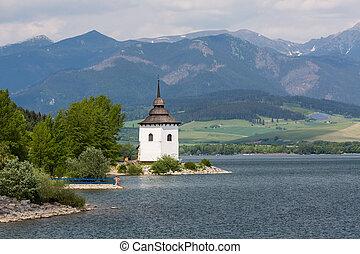 Gothic church Havranok at Lake Liptovska Mara, Slovakia -...