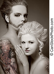 Gothic couple - Duotone portrait of pierced tattooed man and...