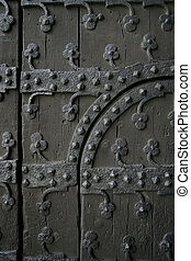 Section of an old gothic door showing the ironwork. (in Brussels, Belgium)