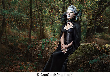 Gothic girl in the forest. - Gothic girl in black raincoat...