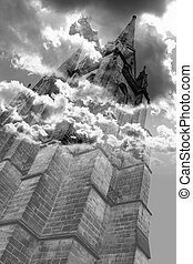 The ancient tower stands out against the sky and the clouds completely wraps it in a mystery glow