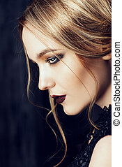 gothic makeup - Vogue shot of a beautiful young woman with...