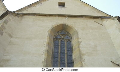 Gothic Stained Glass Window - Tilt shot along a high stained...