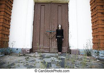 Gothic Style Girl Near A Door