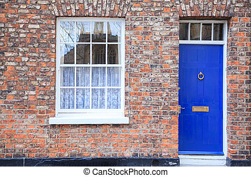 Windows and door on Gothic style Brick house