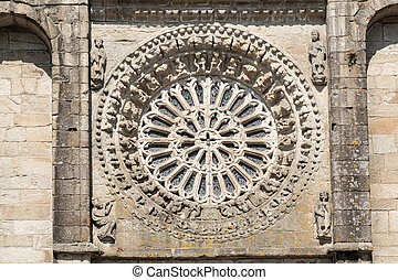 Gothic style rosette made of stone and glass. Antique church of Noia, Galicia, Spain