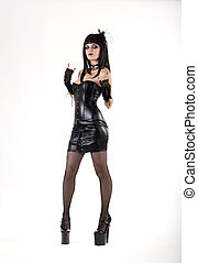 Gothic woman in sexy leather outfit