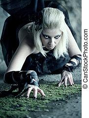 Gothic woman creep on the floor