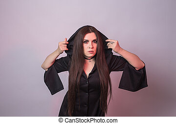 Gothic young woman in witch halloween costume
