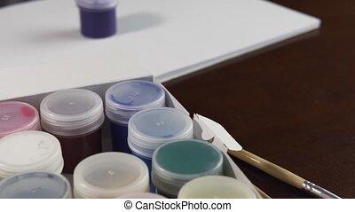 Gouache Ink Jars Opening - Kid opens a jar of blue gouache...