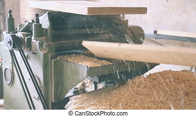 Gouging the wooden board's on machine