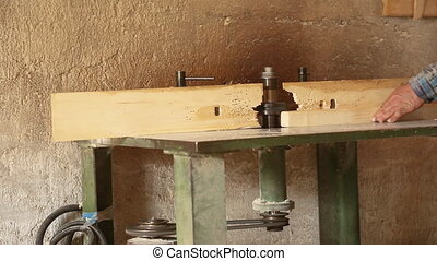 Gouging the wooden square beam on machine