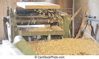 Gouging the wooden square beam's on machine