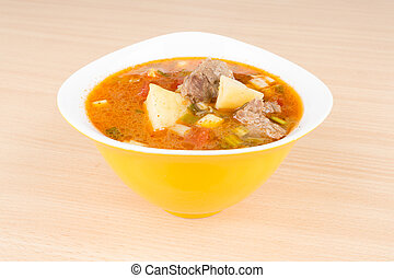 Goulash soup in a yellow bowl