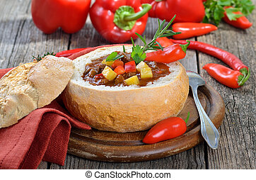 Goulash soup - Hot Hungarian goulash soup in a loaf