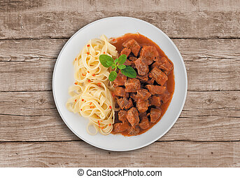 Goulash soup with spaghetti. A Serbian traditional dish made...
