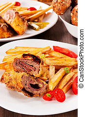 Gourment meat stuffed with cheese and prosciutto