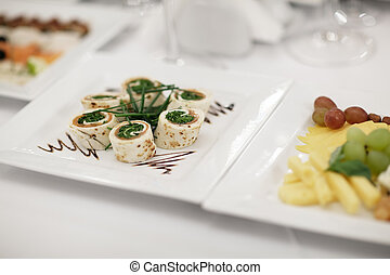 Plate of gourmet appetizers displayed on a table at a restaurant or catered function. Nice shallow depth of field
