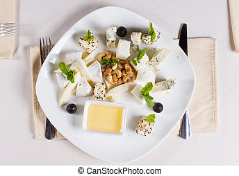 Gourmet appetizers with cashew nuts and sauce