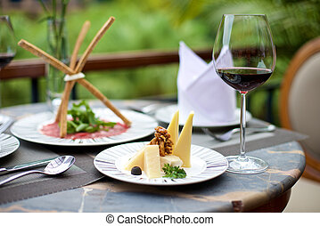 Gourmet Appetizers with various cheese and wine