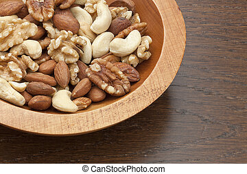 Gourmet Assorted Nuts on a wooden bowl