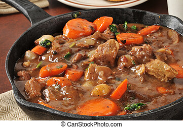 Gourmet beef stew served in a cast iron skillet - A skillet ...
