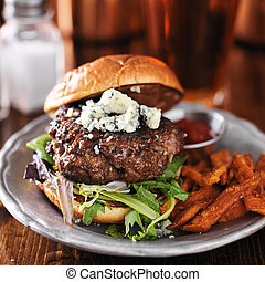 gourmet burger with blue cheese and sweet potato fries